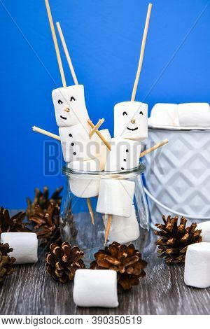 Two Happy Funny Marshmallow Snowmen. Marshmallow Friends On Blue Background. Diy. Sweet Treat For Ki