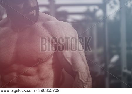 Strong Young Bearded Handsome Athlete Man With Muscular Physique Body On Street Outdoors Workout Spo