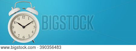 White Vintage Alarm Clock On Blue Background, Long Banner. Urgency, Deadline And Running Out Of Time