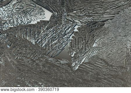 Ice On A Window Glass In Winter. Mystical Abstract Pattern. Crystals Of Frozen Water Close-up. Weath