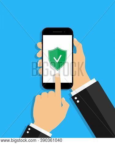 Mobile Antivirus. Check With Shield Antivirus In Phone. Hand Hold Cellphone With Secure Login. Prote