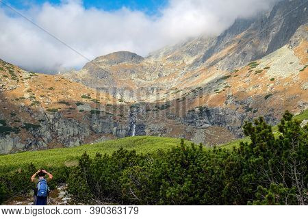 Vysoke Tatry, Slovakia - October 10, 2018: Hikers On Trail At Great Cold Valley,  Vysoke Tatry (high