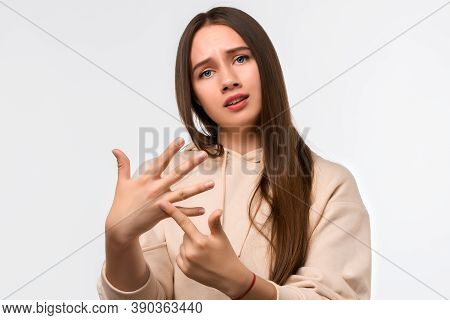 Young Pretty Woman With Long Chestnut Hair Shows Ring Finger Pointing The Absence Of A Ring, On It S