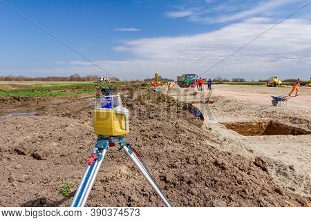 Total Center Device With Laser For Leveling Other Devices To Level Construction Site.