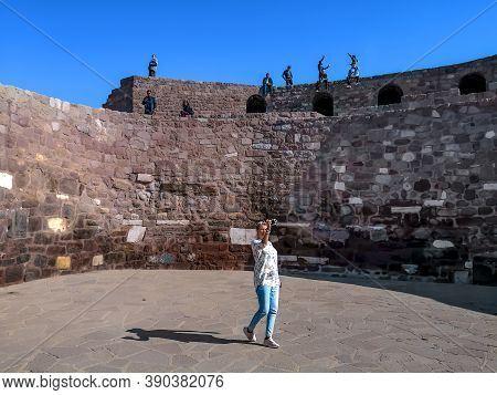 Turkey, Ankara - October 23, 2019: Tourists Inside A Circular Square Against The Background Of The F