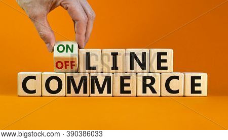 Time To Online Commerce. Male Hand Turns The Cube And Changes The Expression 'offline Commerce' To '