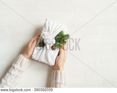 Woman Hands Hold Christmas Reusable Sustainable Gift. Christmas Reusable Sustainable Gift Wrapping A