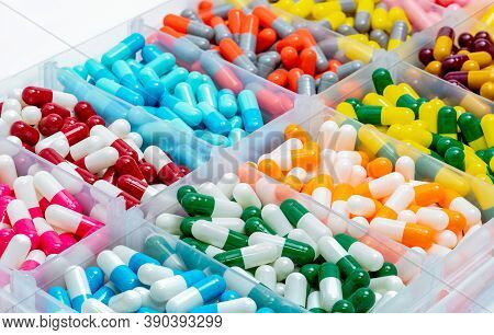 Colorful Capsules Pill In Plastic Box.  Pharmaceutical Industry. Pharmacy Drugstore Products. Drug I