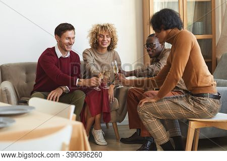 Full Length View At Multi-ethnic Group Of Contemporary Adult People Clinking Champagne Glasses While