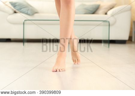 Front View Of Beautiful Woman Legs And Feet Walking On The Floor In The Living Room At Home