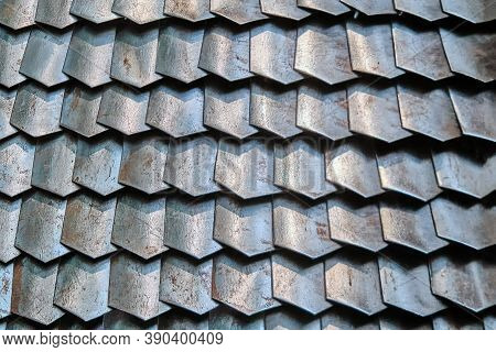 Texture Of Ancient Roman Armor Plates, Lorica. Background Of Rusty Chain Mail Armor From Connected P