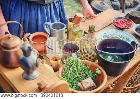 A Woman Prepares Food For American Immigrants From Europe. Table With Dishes And Food Of The First A