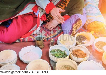 Spices In Bowls By The Shopkeeper In The Old Bazaar. Seasoning And Herbs For Sale From The Seller On