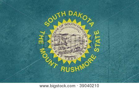 Grunge South Dakota state flag of America, isolated on white background.