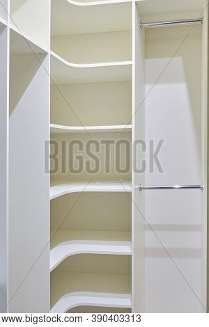 New Built-in Furniture In The Dressing Room. Modern Storage Room, Textured