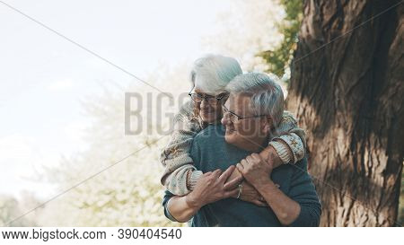 Happy Old Enjoying Day In Park. Senior Man Flirting With Elderly Woman. Dance In Autumn Day. High Qu