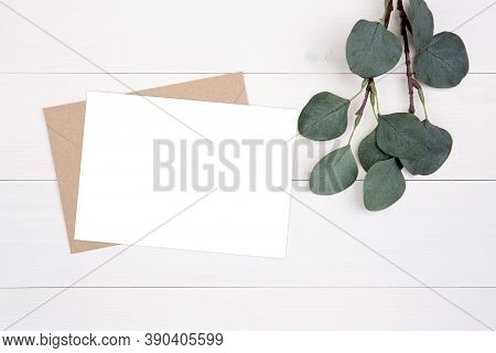 Blank Paper Sheet Copy Space With Mockup And Leaf On Wooden Table, Card, Poster And Envelope, Postca