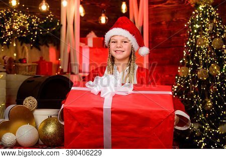 Child Having Fun On Christmas Eve. Happiness And Joy. Girl Santa Claus Costume Received Gift. Santa