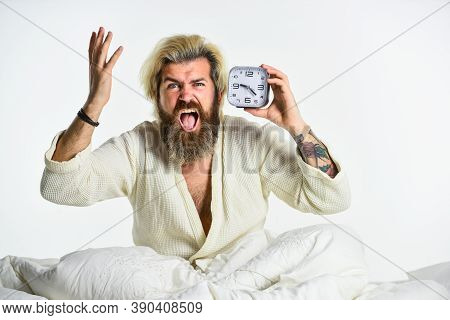 Early Morning Routine. Bearded Man In Bed With Alarm Clock Ringing. Time Management. Need To Relax.