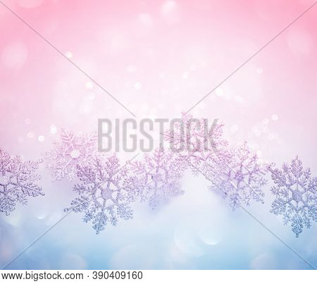 Festive winter background with decorative snowflakes in flying. Christmas, Winter or New Year concept with snowflakes. Flat lay, copy space.