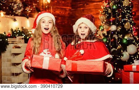Unexpected Surprise. Little Girl Sisters In Red Hats. We Are Family. Elf Children. Xmas. Santa Claus