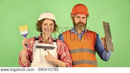 Diy Repair. Construction Workers. Home Renovation. Cheerful Couple Renovating House. Woman Builder H
