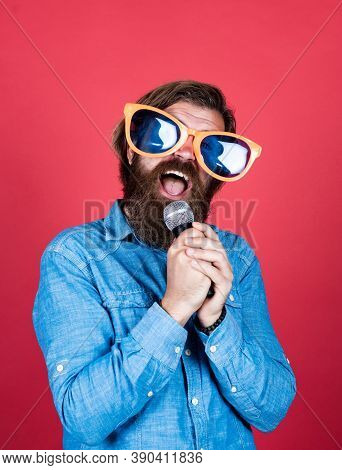 Let Music Flow In Your Heart. Performer Having Fun. Mature Bearded Man In Funny Party Glasses Sing S