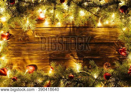 Border Art Design With Christmas Tree, Baubles And Light Garland Blurred Christmas Background, With