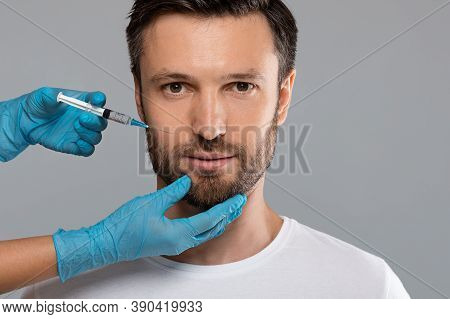 Closeup Of Middle-aged Man Getting Anti-aging Procedure At Clinic Or Salon, Copy Space. Cosmetician
