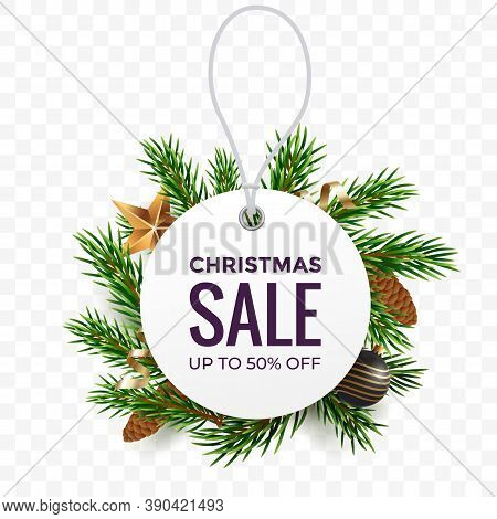 White Round Price Tag Against The Background Of Fir Branches With Christmas Decorations. Christmas S