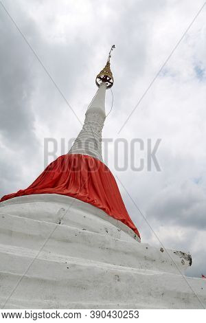 White Leaning Pagoda Has A Red Cloth Tied At The Top Beside Chao Phraya River At Koh Kret (kret Isla