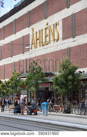 Stockholm, Sweden - August 23, 2018: People Walk By Ahlens City Department Store In Drottninggatan S