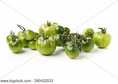 Heap Of Unripe Green Tomatoes Over White Background, Unripe Tomatoes Can Be Fried Or Used For Relish