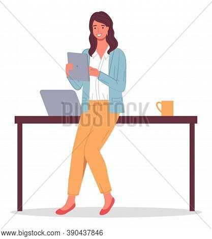 Businesswoman Holding Digital Tablet In Hands. Business Lady Leaning On Table With Laptop, Cup. Conf