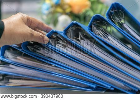 Lawyer Checking Blue Document Binder File Folders Stack On Office Desk In Organization With Report P