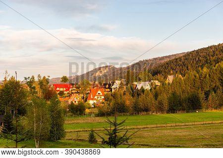 Traditional Polish Highlander Style Houses In Krzeptowki, Zakopane, Tatra Mountains, During Sunset,