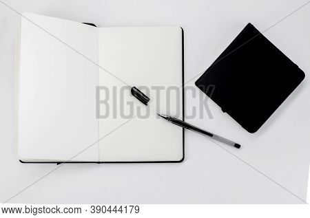 Black Small Closed Square Notepad And Large Open Notebook With Blank White Pages And Ballpoint Pen W
