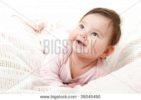 cute funny infant baby looking up in left corner and happy smiling, beautiful kid's face closeup with copyspace over white