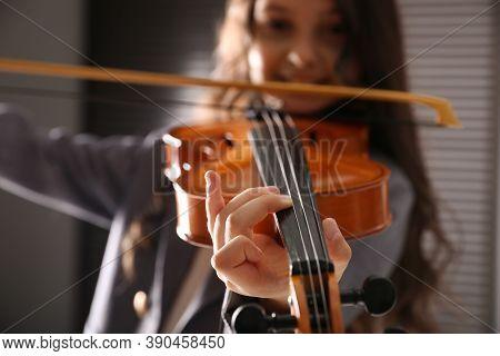 Preteen Girl Playing Violin At Music Lesson, Closeup