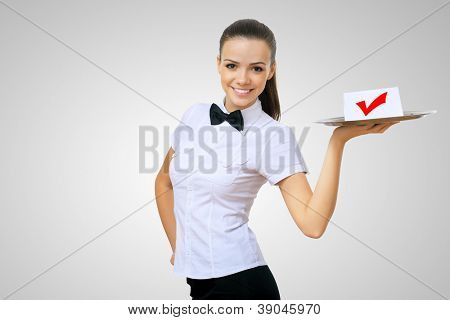 Waitress holding a tray with symbol of success on it