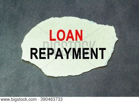 Word Concept Written On A Table . Concept Word Loan Repayment On A Beautiful Background