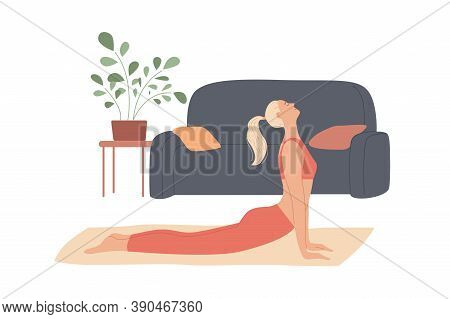 Woman Exercises At Home, Stretches Out, Curves Her Back Lying On The Floor
