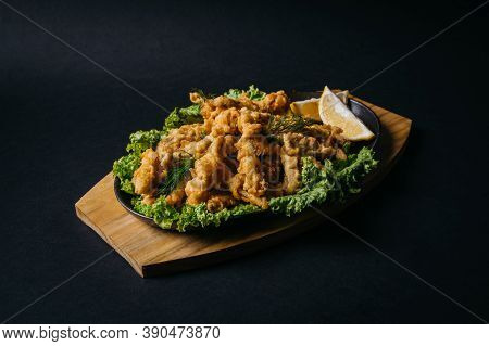Crispy Fried Battered Smelt Fish With Lemon On Wooden Board. High Quality Photo