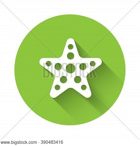 White Starfish Icon Isolated With Long Shadow. Green Circle Button. Vector