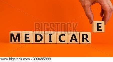 Wooden Cubes With Word 'medicare'. Male Hand. Beautiful Orange Background. Medical Concept. Copy Spa