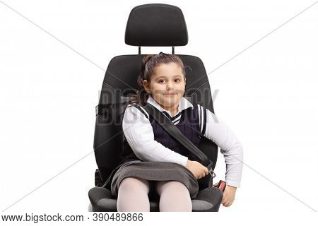 Child sitting in a car seat and putting a seatbelt on isolated on white background