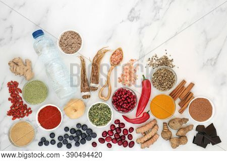 Vegan health food for healthy eating very high in nutritional values with antioxidants, anthocyanins, minerals, vitamins, omega 3,  dietary fibre & smart carbs. Ethical eating concept. On marble.