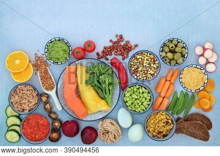 Health food for a low glycemic diabetic diet. High in omega 3, protein, antioxidants, fibre, minerals & vitamins. All foods below 55 on the GI index. Top vieW on mottled blue. Healthcare concept.