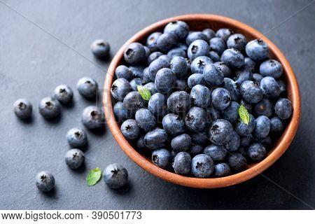 Organic Blueberries In Bowl. Tasty Healthy Juicy Blueberries