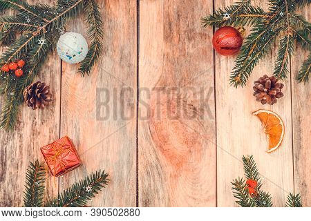 Christmas Frame Made Of Fir Branches, Red Rowan Berries, Red Gift Box, Pine Cones, Christmas Balls,